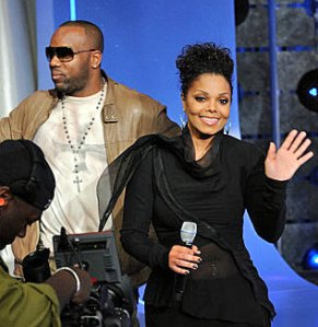 Stars of Why Did I get Married Too, Janet Jackson & Malik Yoba, Yoba has Facist Iron Cross on T-Shirt and a Christian Cross